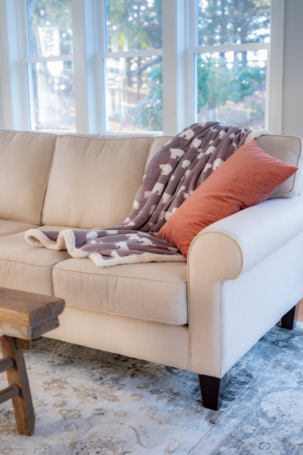 Clean microfiber couch with a magic eraser
