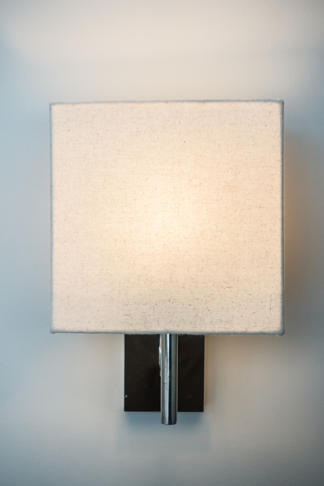 Small space living hacks are the best hacks for those who live in small places. If you want to add light but don't have room for a floor lamp, try a wall mounted sconce.