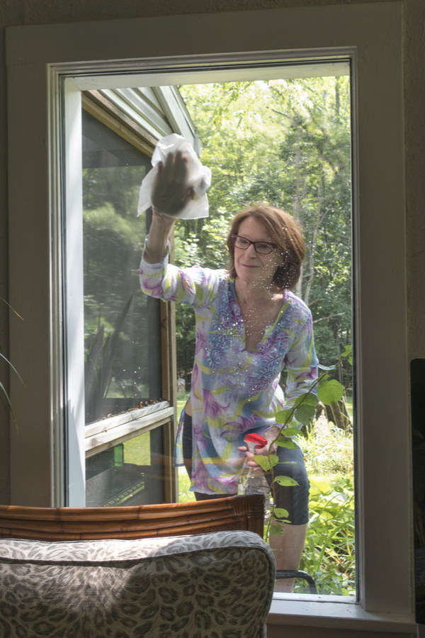 clean windows fast-woman washing windows with homemade solution