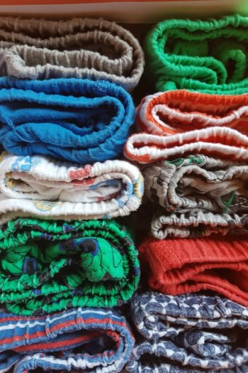 If you're trying to figure out the best ways for storing baby clothes, try rolling or folding your clothes really small. For more tips on storing baby clothes, look here.