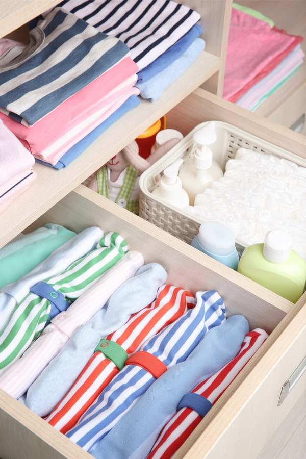 If you're a fan of Marie Kondo, you know she suggests standing things upright, so you can see what you have. For more tips on storing baby clothes, look here.