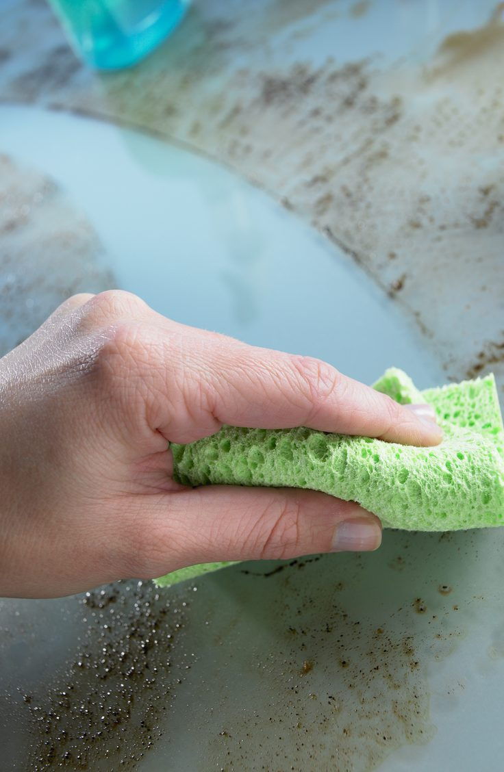 Conquer kitchen grease with an easy, two-ingredient homemade degreaser cleaner. You will love how well it works!
