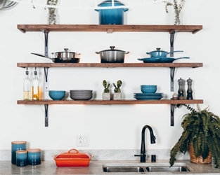 Kitchen tools and cookware neatly arranged on a rack