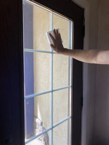 How To Clean Windows-cleaning glass on doors