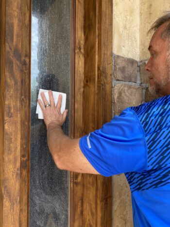 Clean windows fast-man washing a door window